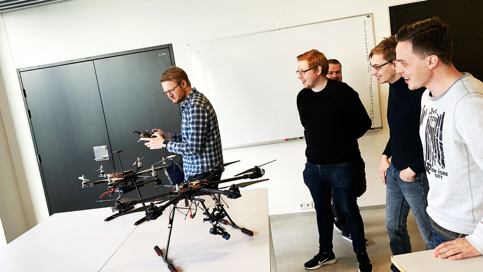 Students try out a drone in the RU Physics Lab.