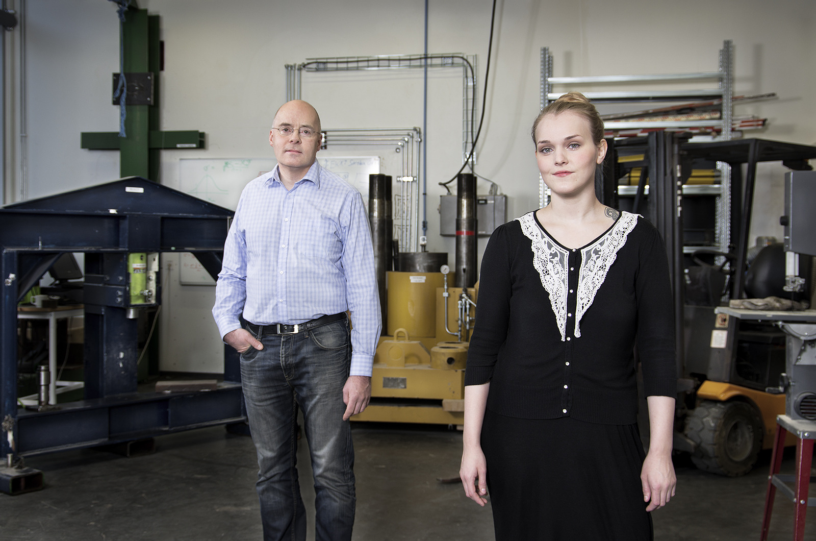 A woman and a man in a industrial lab